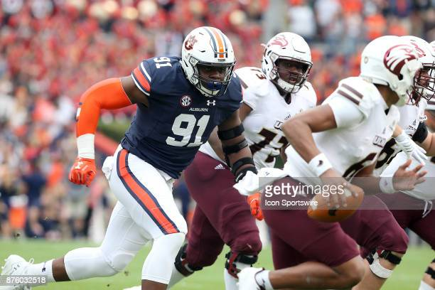Auburn Tigers defensive lineman Nick Coe chases the quarterback during a football game between the Auburn Tigers and the LouisianaMonroe Warhawks...