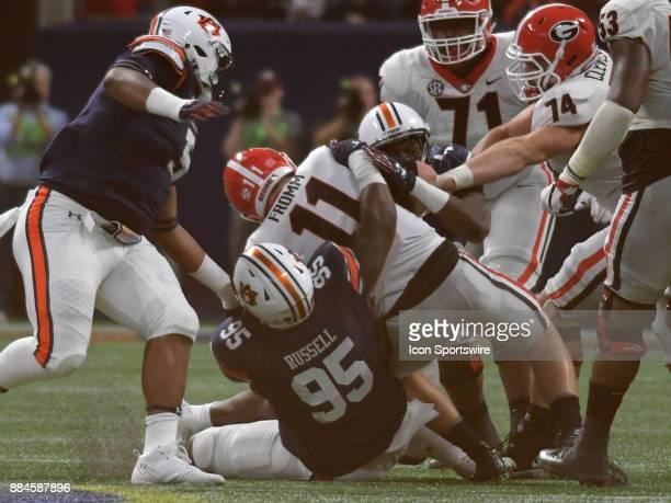 Auburn Tigers defensive linemen Dontavius Russell sacks Georgia Bulldogs quarterback Jake Fromm during the SEC Championship game between the Georgia...