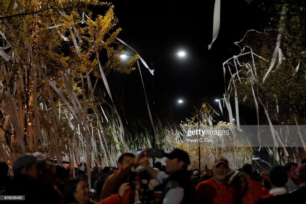 Auburn Tigers fans celebrate at Toomer's Corner after the Iron Bowl victory over the Alabama Crimson Tide at Jordan Hare Stadium on November 25, 2017 in Auburn, Alabama.