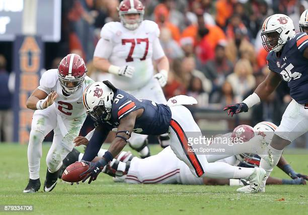 Auburn Tigers linebacker Tre' Williams recovers a fumble during a football game between the Auburn Tigers and the Alabama Crimson Tide Saturday...