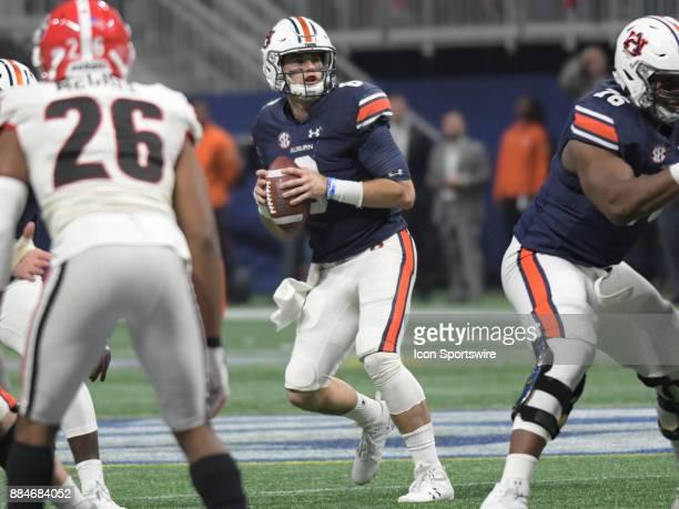 Auburn Tigers quarterback Jarrett Stidham drops back to pass during the SEC Championship game between the Georgia Bulldogs and the Auburn Tigers on...