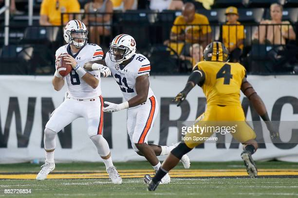 Auburn Tigers quarterback Jarrett Stidham looks to pass the ball after faking a hand off to running back Kerryon Johnson during the first half of a...
