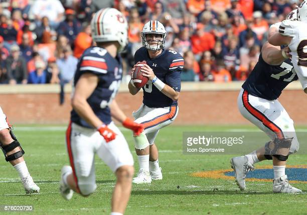 Auburn Tigers quarterback Jarrett Stidham looks to throw the ball to wide receiver Will Hastings during a football game between the Auburn Tigers and...