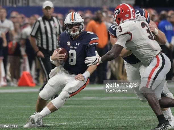 Auburn Tigers quarterback Jarrett Stidham rushes the ball during the SEC Championship game between the Georgia Bulldogs and the Auburn Tigers on...
