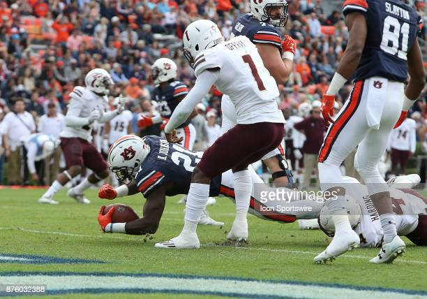 Auburn Tigers running back Kerryon Johnson dives into the end zone for a touchdown during a football game between the Auburn Tigers and the...