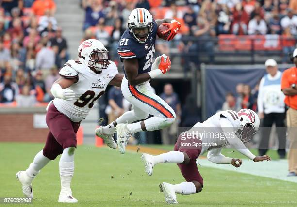 Auburn Tigers running back Kerryon Johnson leaps over a defender during a football game between the Auburn Tigers and the LouisianaMonroe Warhawks...