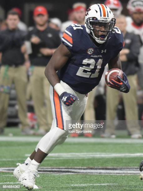 Auburn Tigers running back Kerryon Johnson rushes the ball during the SEC Championship game between the Georgia Bulldogs and the Auburn Tigers on...