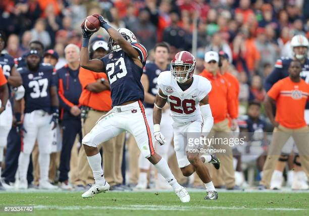 Auburn Tigers wide receiver Ryan Davis catches a pass of a first down during a football game between the Auburn Tigers and the Alabama Crimson Tide...