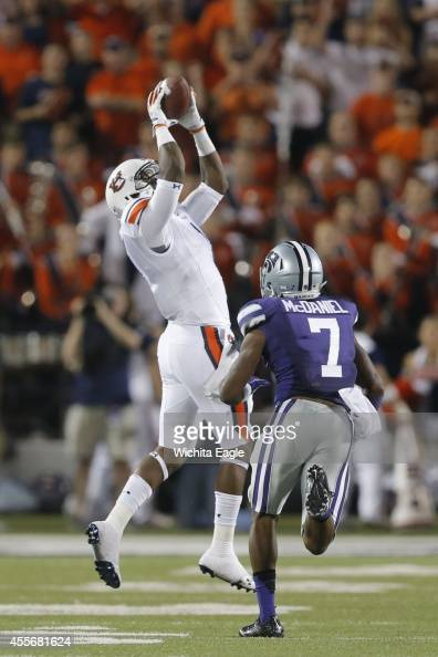 Auburn wide receiver D'haquille Williams hauls in a long pass over Kansas State defensive back Danzel McDaniel late in the fourth quarter at Snyder...