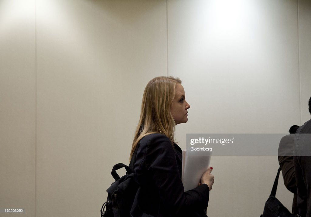 Aubyn Peterson of New York waits to speak to a recruiter at a job fair organized by United Career Fairs in New York, U.S., on Tuesday, Feb. 19, 2013. The U.S. Labor Department is scheduled to release initial jobless claims figures on Feb. 21. Photographer: Jin Lee/Bloomberg via Getty Images