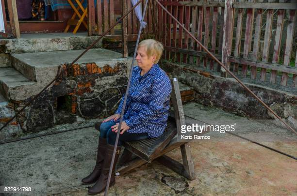Сaucasian woman sitting inside iron mystic pyramid in the village of paranapiacaba at winter festival in brazil