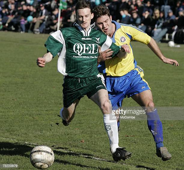 Auckland Central United's Paul Urlovic and Christchurch Halswell Uniteds Darren Scott compete for the ball in their Chatham Cup Semi Final in...