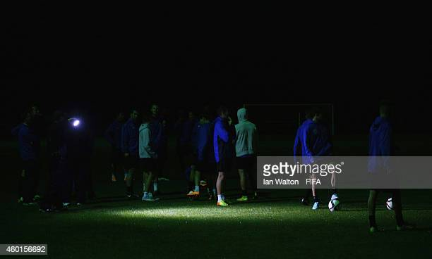 Auckland City FC players warm up in the dark after the light went out during a training session prior to the match on Wednesday against Moghreb...