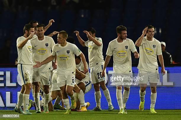 Auckland City players celebrate their equalising goal during the FIFA Club World Cup semifinal football match between San Lorenzo vs Auckland City FC...