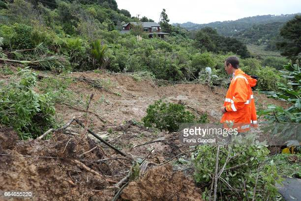 Auckland Council Geotechnical Specialist Ross Roberts inspects the large landslip which has cut off access to three homes in Landing Rd Titirangi...