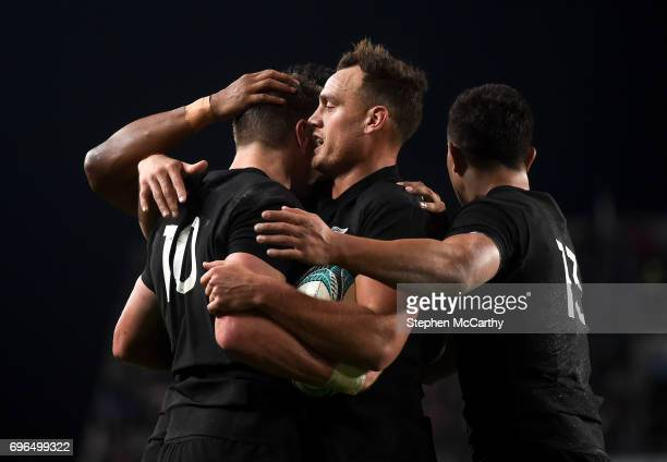 Auckland New Zealand 16 June 2017 Beauden Barrett is congratulated by his New Zealand teammates Israel Dagg and Anton LienertBrown after scoring...