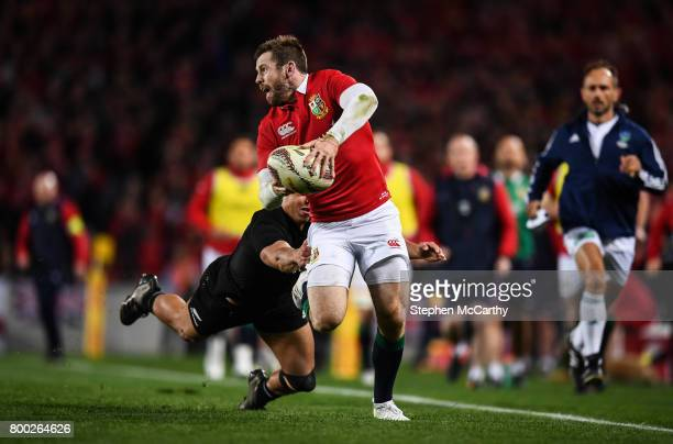 Auckland New Zealand 24 June 2017 Elliot Daly of the British Irish Lions is tackled by Anton LienertBrown of New Zealand during the First Test match...