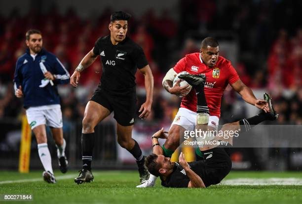 Auckland New Zealand 24 June 2017 Kyle Sinckler of the British Irish Lions is tackled by Aaron Cruden of New Zealand during the First Test match...