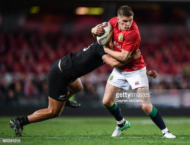 Auckland New Zealand 24 June 2017 Owen Farrell of the British Irish Lions is tackled by Anton LienertBrown of New Zealand during the First Test match...