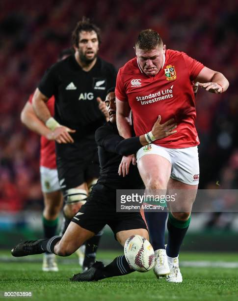 Auckland New Zealand 24 June 2017 Tadhg Furlong of the British Irish Lions is tackled by Aaron Smith of New Zealand during the First Test match...