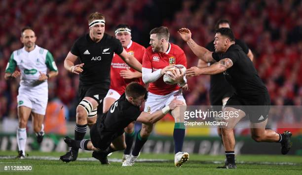 Auckland New Zealand 8 July 2017 Elliot Daly of the British Irish Lions is tackled by Jordie Barrett left and Codie Taylor of New Zealand during the...
