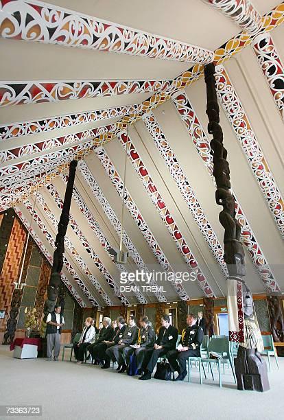 Finland President Tarja Halonen and her husband Pentti Arajarvi sit in a traditional Maori meeting house as Maori kaumatua Matt Mahi talks during her...