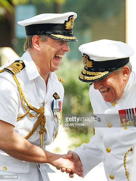 Prince Andrew of Britain shares a laugh with Rear Admiral David Ledson chief of Navy upon his arrival at Devonport Naval Base in Auckland 19 March...