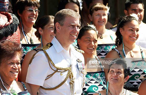 Prince Andrew of Britain stands with a group of women in traditional maori costume during a visit to Te Whetu Moana Marae at the Devonport Naval Base...