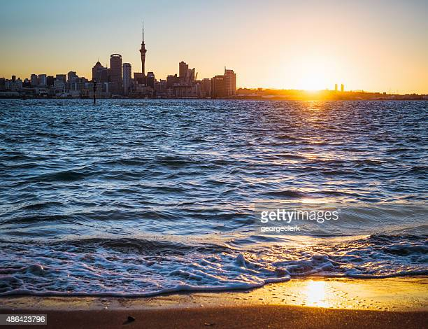 Auckland skyline at sunset from Devonport beach