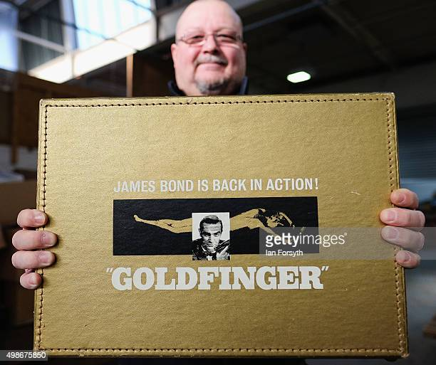 Auction house employee Richie Humphrey holds a Goldfinger briefcase used to carry movie information to cinemas and which finally sold for 223200 GBP...