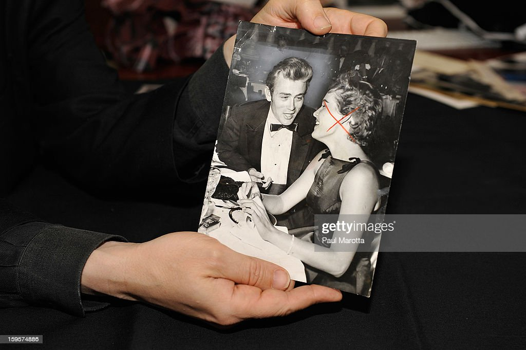 RR Auction Vice President Bobby Livingston holds a news photograph of James Dean on January 16, 2013 at RR Auction in Amherst, New Hampshire.