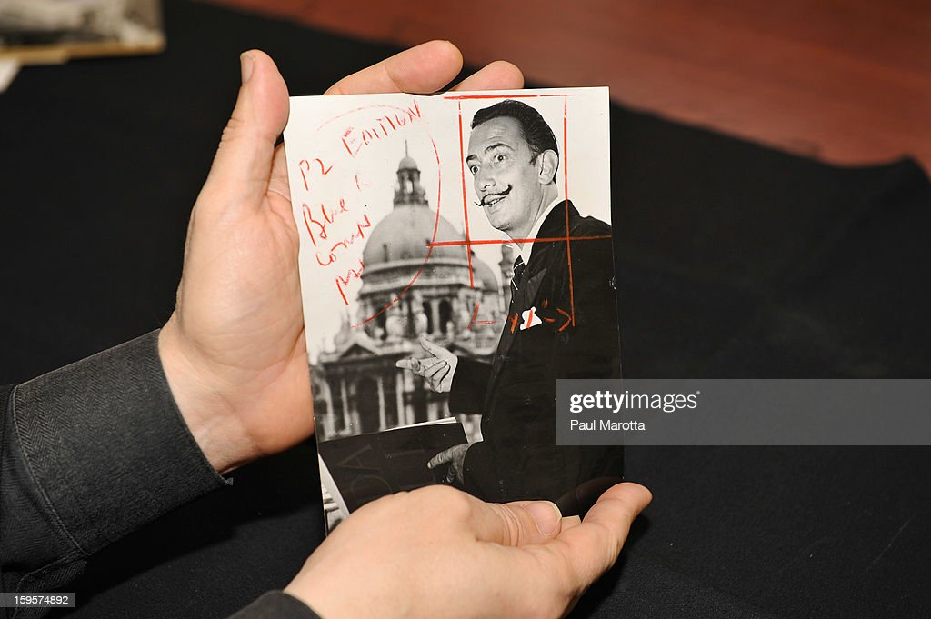 RR Auction Vice President Bobby Livingston holds a news photograph of <a gi-track='captionPersonalityLinkClicked' href=/galleries/search?phrase=Salvador+Dali&family=editorial&specificpeople=94477 ng-click='$event.stopPropagation()'>Salvador Dali</a> on January 16, 2013 at RR Auction in Amherst, New Hampshire.