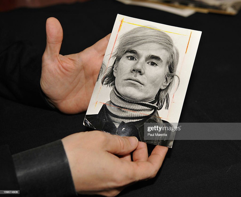 RR Auction Vice President Bobby Livingston holds a news photograph of Andy Warhol on January 16, 2013 at RR Auction in Amherst, New Hampshire.