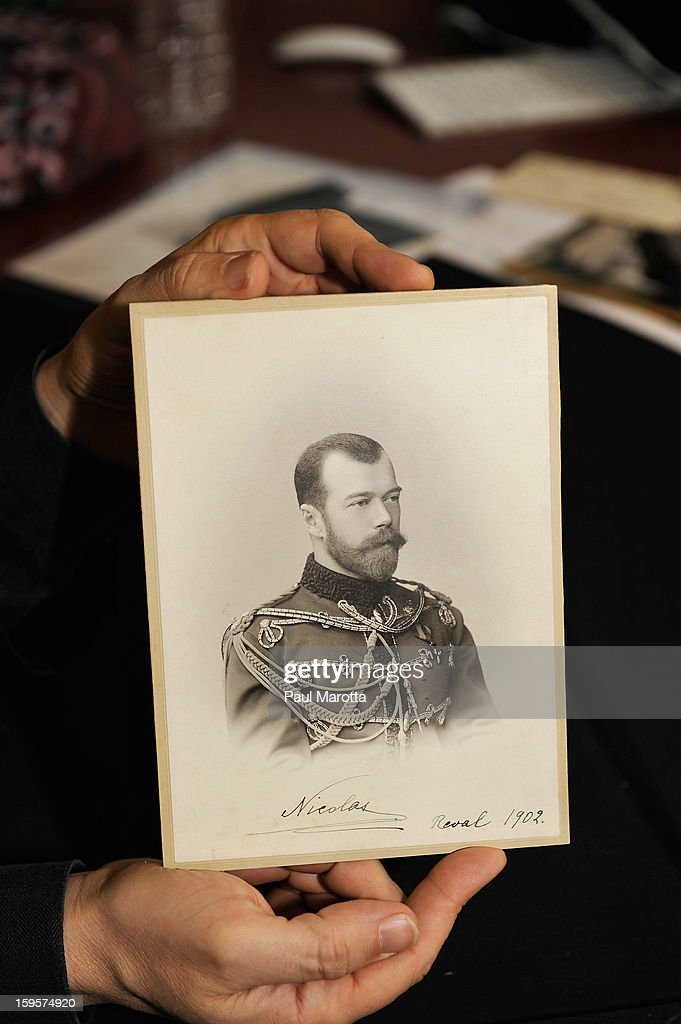 RR Auction Vice President Bobby Livingston holds a rare autographed photograph of Czar Nicolas of Russia on January 16, 2013 at RR Auction in Amherst, New Hampshire.