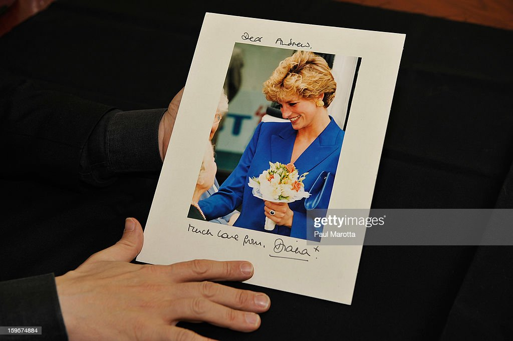RR Auction Vice President Bobby Livingston holds an autographed photograph of Princess Diana on January 16, 2013 at RR Auction in Amherst, New Hampshire.