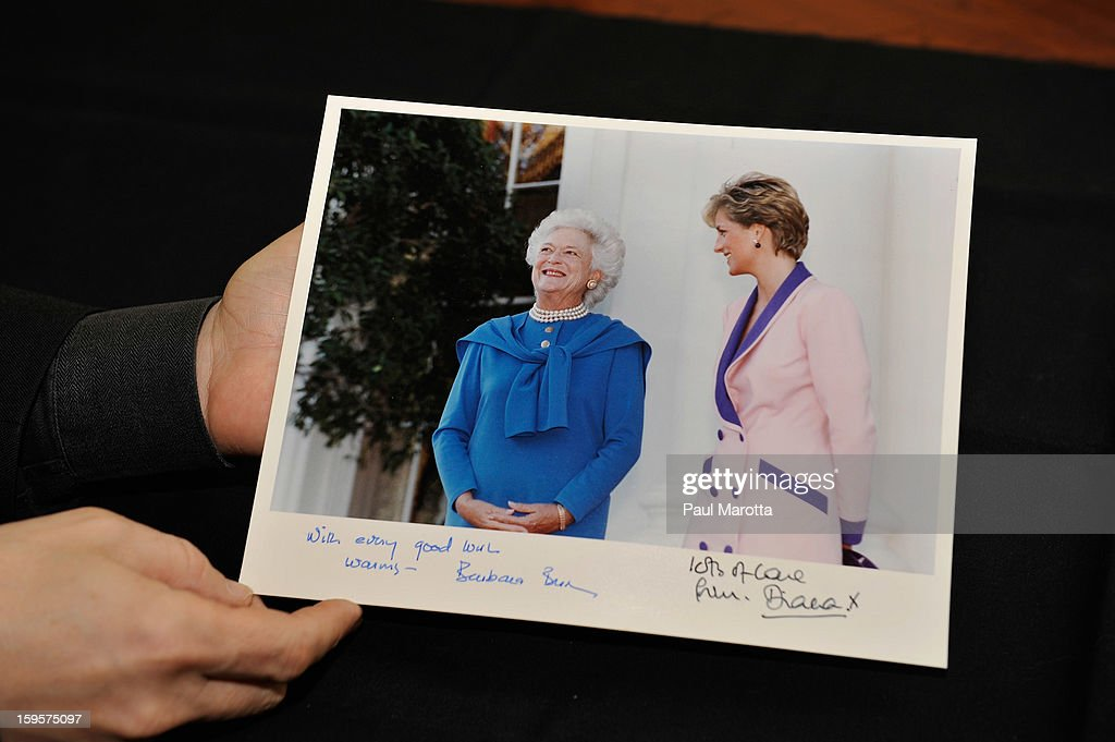 RR Auction Vice President Bobby Livingston holds an autographed photograph of First Lady Barbara Bush and Princess Diana on January 16, 2013 at RR Auction in Amherst, New Hampshire.