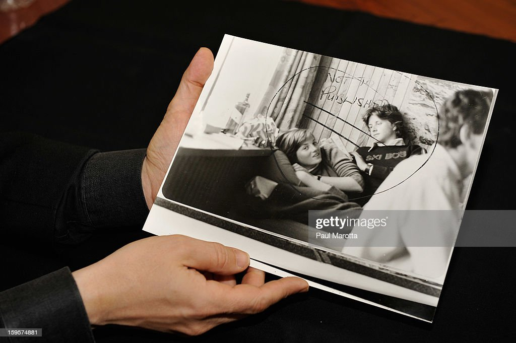 RR Auction Vice President Bobby Livingston holds an early 8 x 10 glossy news photo of a young Diana Princess of Wales and Adam Russell emphatically labeled 'not to be published,' which will be featured in an upcoming Photography auction, from New Hampshire based RR Auction in January. This early glossy news photo of a young Diana lying in bed, with a friend seated behind her, is stamped February 1981 on the back side. The auction will begin January 17 and runs through January 24, on January 16, 2013 at RR Auction in Amherst, New Hampshire.