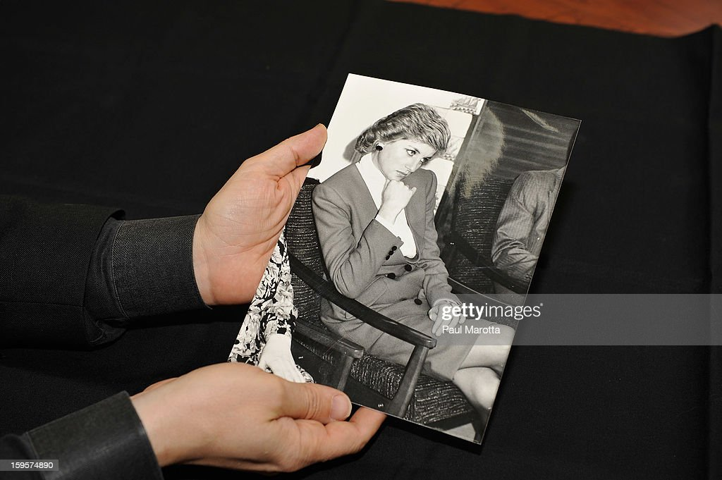 RR Auction Vice President Bobby Livingston holds an original 1988 news photograph of Princess Diana observing a marriage conflict resolution seminar, on January 16, 2013 at RR Auction in Amherst, New Hampshire.