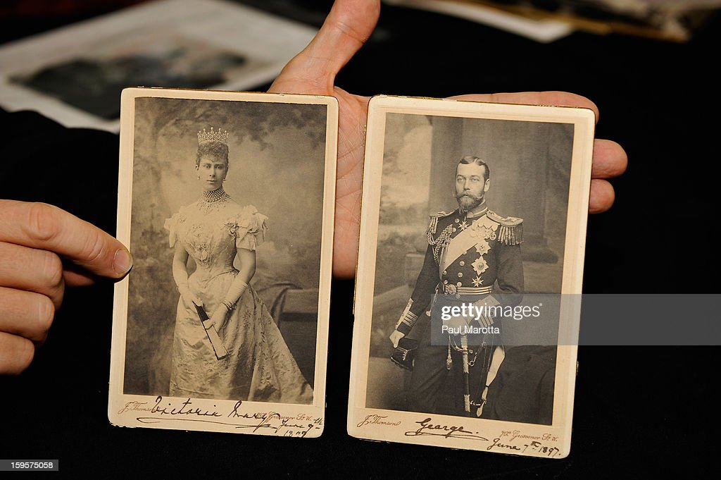 RR Auction Vice President Bobby Livingston holds rare autographed photographs of Queen Mary and King <a gi-track='captionPersonalityLinkClicked' href=/galleries/search?phrase=George+V&family=editorial&specificpeople=93661 ng-click='$event.stopPropagation()'>George V</a> on January 16, 2013 at RR Auction in Amherst, New Hampshire.