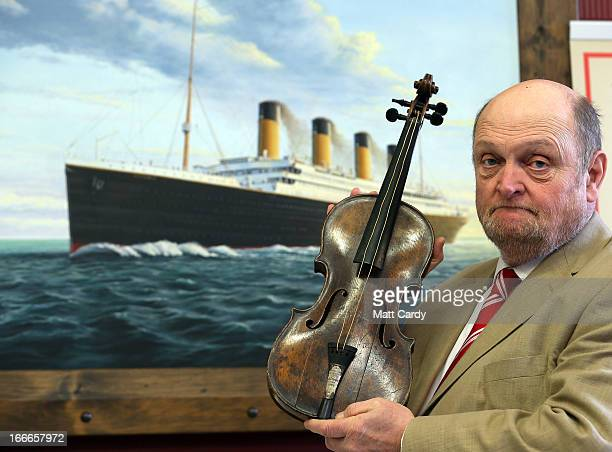 Auctioneer Alan Aldridge of auctioneers Henry Aldridge son holds the violin of Wallace Hartley the instrument he played as the band leader of the...