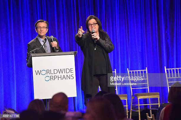Auctioneer Benjamin Doller and comedian Rosie O'Donnell speak on stage during the Worldwide Orphans' 10th Annual Gala Hosted by Katie Couric at...