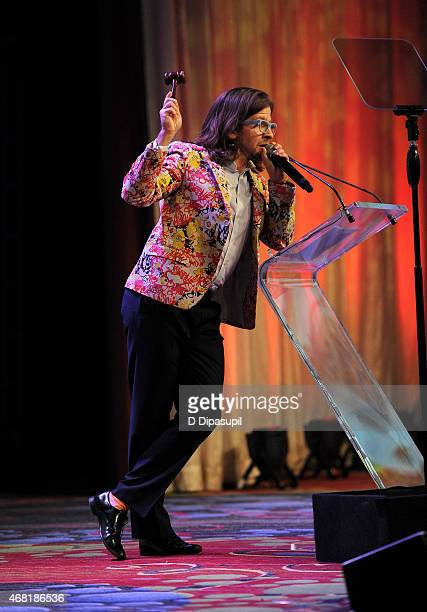 Auctioneer CK Swett speaks onstage at the 7th Annual PFLAG National Straight For Equality Awards Gala at The New York Marriott Marquis on March 30...