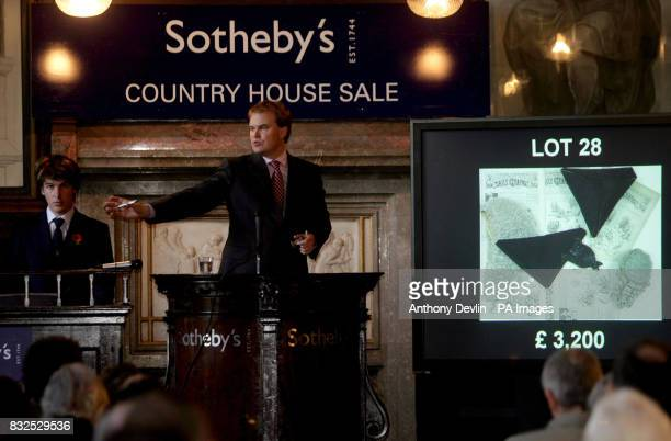 Auctioneer Harry Dalmeny accepts bids for Lot 28 legal robes wigs and accessories from the 19th century including a black cap used when delivering...