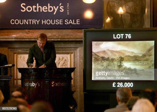 Auctioneer Harry Dalmeny accepts bids for Lot 76 Looking South From Near Red Brow Towards Rosthwaite by John Constable which sold for 31200 in...