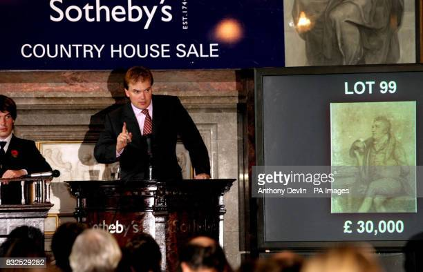 Auctioneer Harry Dalmeny accepts bids for Lot 99 a portrait drawing of Samuel Taylor Coleridge who wrote the Rhyme of the Ancient Mariner signed and...