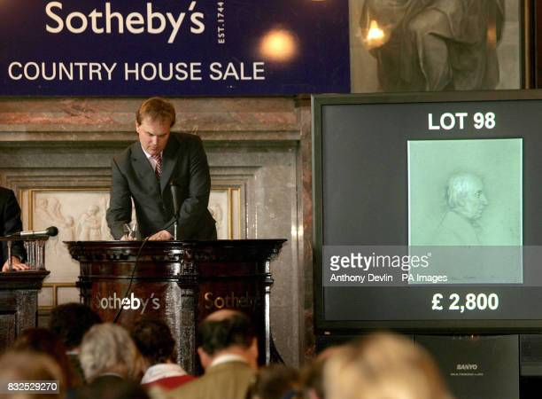 Auctioneer Harry Dalmeny accepts the highest bid of 3360 for Lot 98 a portrait drawing of William Wordworth after Leonard Charles Wyon in today's...
