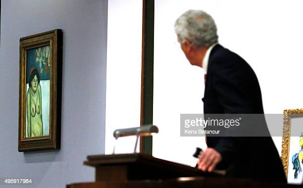 Auctioneer Henry Wyndham shows a Pablo Picasso artwork titled 'La Gommeuse' as it is auctioned at Sotheby's for $67000 on November 5 2015 in New York...