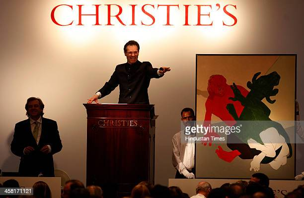 Auctioneer Hugo Weihe interacts with bidder on Tyeb Mehtas acrylic painting Mahishasura painted in 1994 at India first South Asia Art organized by...