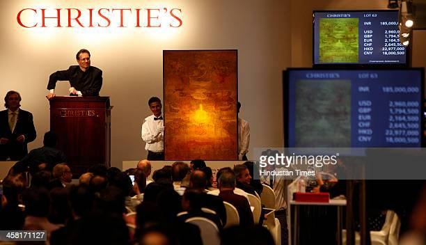 Auctioneer Hugo Weihe interacts with bidder on Vasudeo S Gaitondes untitled oil painting painted in 1979 at India first South Asia Art organized by...