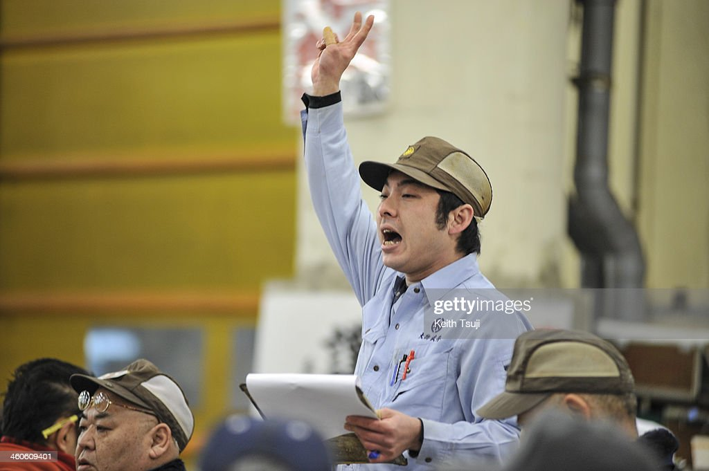 Auctioneer interacts with bidders on the year's first auction at Tsukiji Fish Market on January 5, 2014 in Tokyo, Japan. Tsukiji Fish Market is best known as one of the world's most famous fish markets, handling thousands of tons of seafood daily.